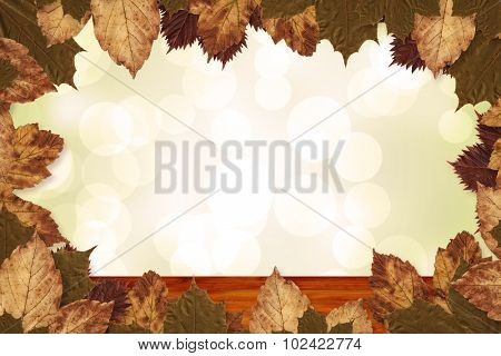 Autumn leaves pattern against bleached wooden planks background