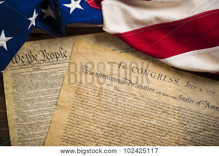 The Declaration of Independence and Constitution of the United States of America with a vintage flag