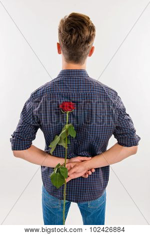 Man Hiding Behind His Back A Red Rose