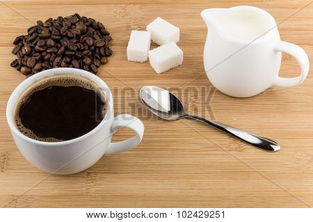 Heap Of Coffee Beans, Hot Drink And Jug Milk