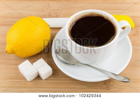 Hot Cup Of Coffee, Lemon, Knife, Spoon And Sugar