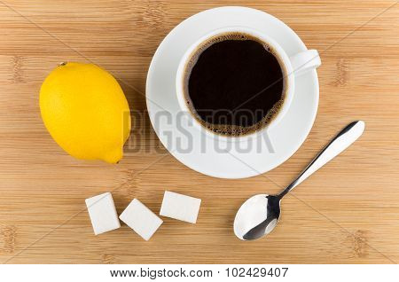 Hot Cup Of Coffee, Lemon, Spoon And Sugar