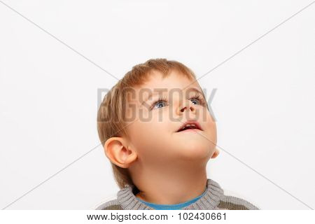 Kid looking up isolated on white