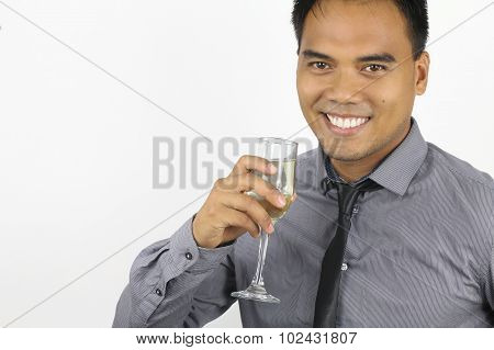 the new year - young filipino with a champagne flute