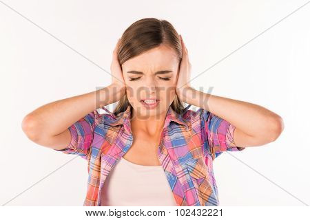 This Is Too Loud! Girl With Her Hands Covering Ears
