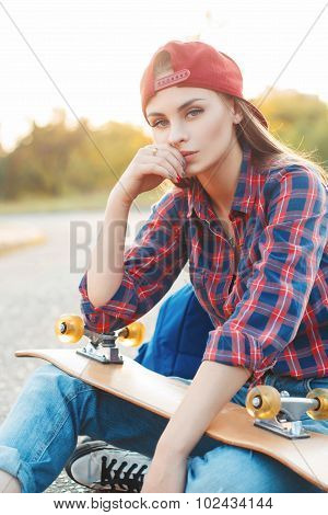 Fashion Lifestyle, Beautiful Young Woman With Skateboard, Backlit At Sunset.