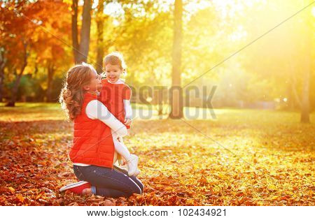Happy Family: Mother And Child Little Daughter Play, Laughing Cuddling On Autumn
