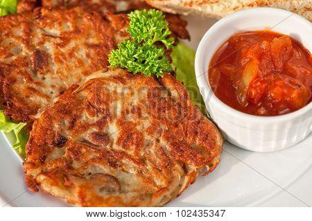 potato pancakes with  toast bread and jam closeup