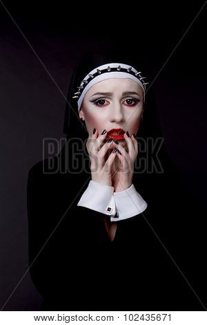 Halloween. Girl Dressed In Evil Sexy Nun