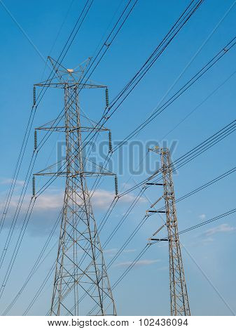 Two High Voltage Transmission Lines Installed On Steel Structure.