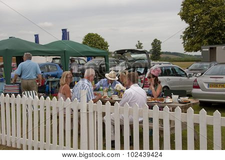 HENLEY, ENGLAND. 01-07-2010. Regatta fans having a picnic in a carpark on day 2 of the Henley Royal Regatta 2010 held on the River Thames.