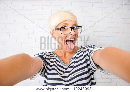 Girl Making Selfie And Showing Her Tongue