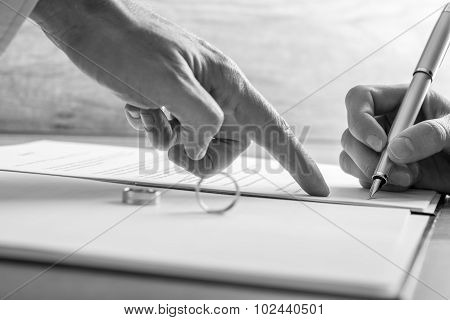 Male Hand Pointing To A Woman Where To Sign Legal Divorce Papers Or Marriage Registry