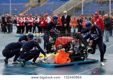 ST. PETERSBURG, RUSSIA - SEPTEMBER 9, 2015: Team Korea during competitions in combat deployment during XI World Championship in Fire and Rescue Sport. First World Championship was held in 2002