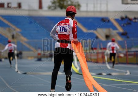 ST. PETERSBURG, RUSSIA - SEPTEMBER 9, 2015: Team Turkey during competitions in combat deployment during XI World Championship in Fire and Rescue Sport. First World Championship was held in 2002