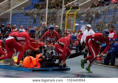 ST. PETERSBURG, RUSSIA - SEPTEMBER 9, 2015: Team Poland during competitions in combat deployment during XI World Championship in Fire and Rescue Sport. First World Championship was held in 2002