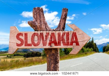 Slovakia wooden sign with road background