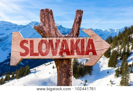 Slovakia wooden sign with winter background
