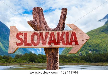 Slovakia wooden sign with countryside background