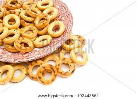 Bagels On A Pink Plate On White