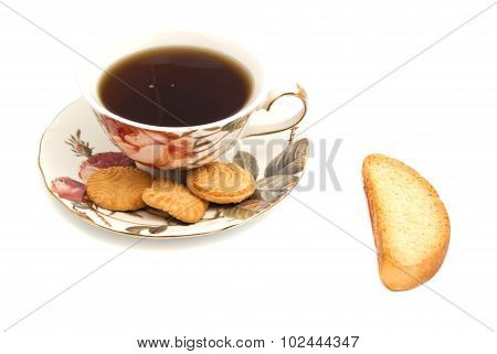 Cup Of Tea, Cookies And Cracker On White