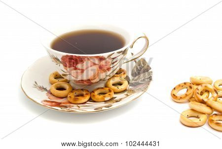 Some Bagels And Cup Of Tea On White