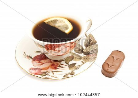 Tea With Lemon And Chocolate On White