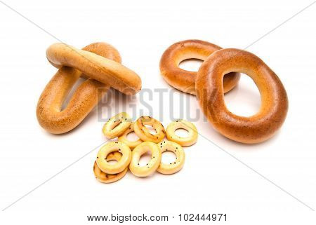Different Tasty Bagels On White