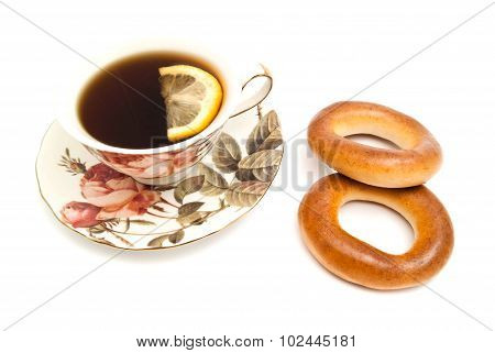 Tea With Lemon And Two Bagels