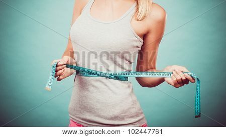Fitness Girl Measuring Her Waistline
