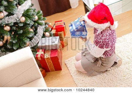 Girl In Christmas, Looking Inside Gift Box