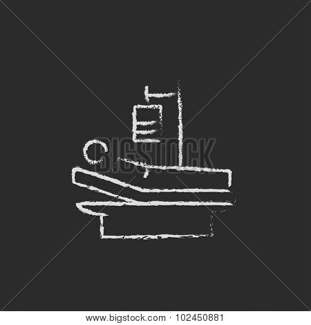 Patient lying on bed hand drawn in chalk on a blackboard vector white icon isolated on a black background.