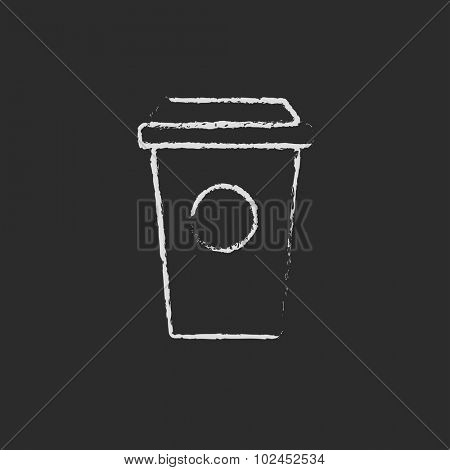 Disposable cup hand drawn in chalk on a blackboard vector white icon isolated on a black background.