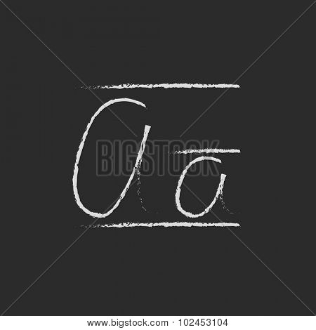 Cursive letter a hand drawn in chalk on a blackboard vector white icon isolated on a black background.