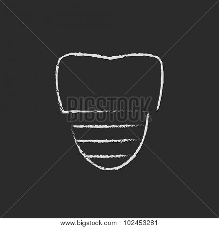 Tooth implant hand drawn in chalk on a blackboard vector white icon isolated on a black background.