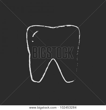 Tooth hand drawn in chalk on a blackboard vector white icon isolated on a black background.
