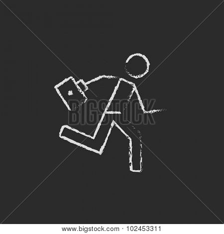 Paramedic running with first aid kit hand drawn in chalk on a blackboard vector white icon isolated on a black background.