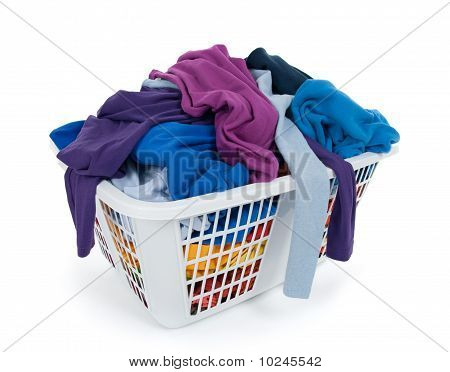 Bright Clothes In Laundry Basket. Blue, Indigo, Purple.
