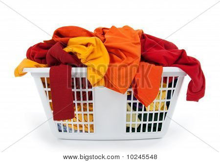 Colorful Clothes In Laundry Basket. Red, Orange, Yellow.