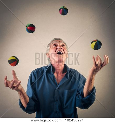 Man juggling with little balls