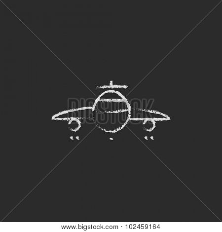 Airplane hand drawn in chalk on a blackboard vector white icon isolated on a black background.