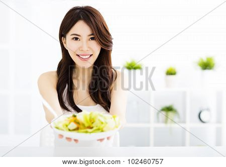 Beautiful  Young Woman Eating And Showing Healthy Food