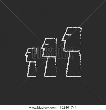 Moai statues on Easter Island hand drawn in chalk on a blackboard vector white icon isolated on a black background.