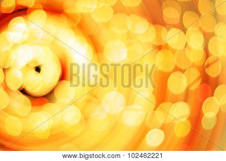 Rotary motion bokeh background of bright orange lights