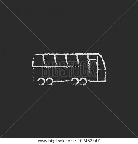 Tourist bus hand drawn in chalk on a blackboard vector white icon isolated on a black background.