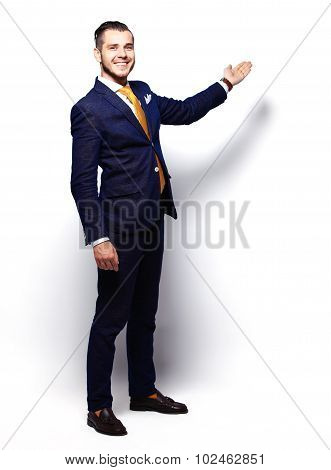 Happy Young Businessman Presenting Isolated Over White Backgroun