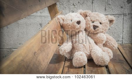 Teddybears on a park bench