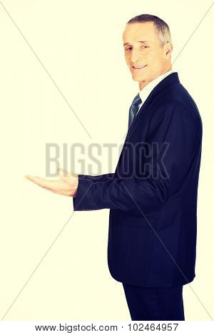 Businessman holding something invisible in both hands.
