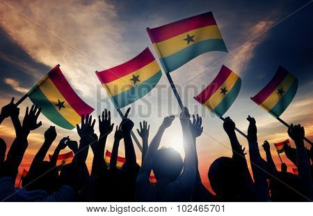 Silhouettes of People Holding Flag of Ghana