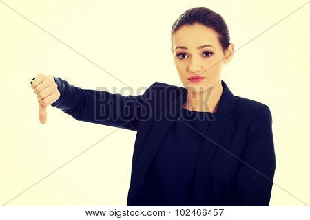 Beautiful unhappy businesswoman with thumb down.